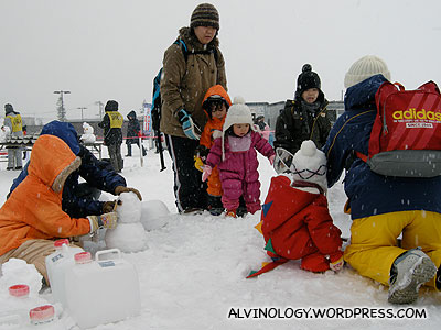 More kids playing in the snow