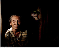 the lady in the hut (pixelegant) Tags: portrait beach fishermen photojournalism cantilan burned mindanao photojournalist surigaodelsur