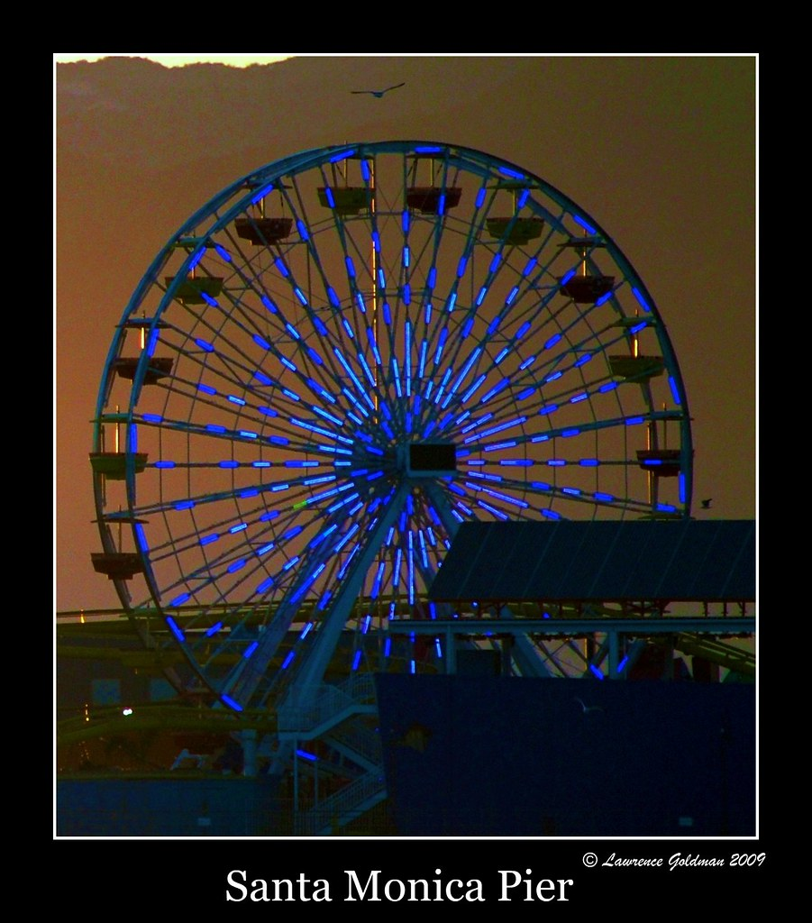 Ferris Wheel with Blue Light Rays