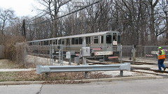 Northbound CTA Purple line train at the Isabella Street railroad crossing. Wilmette Illinois. Early March 2009.