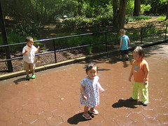 Kids running through sprinklers to cool off