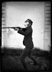 Portrait of a boy wearing a mask holding a rifle