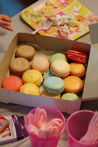 Assorted macarons in a bakery box.