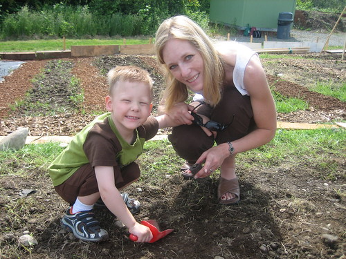 Aidan and Mommy helping plant the preschool pumpkin patch for this fall