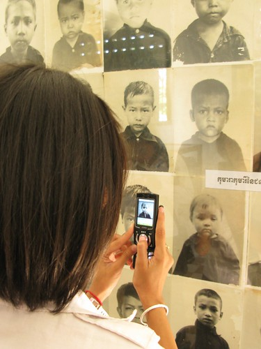 Cambodian student takes picture of children killed at Tuol Sleng Museum, S-21 - Phnom Penh, Cambodia