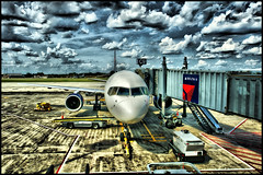 plane (Dan Anderson (dead camera, RIP)) Tags: travel blue vacation sky saint minnesota tarmac st clouds plane airplane paul fly airport gate northwest jet minneapolis msp delta international mpls airline gateway passenger twincities asphalt runway mn flights metropolitan hdr docking minneapolisstpaulinternationalairport dananderson