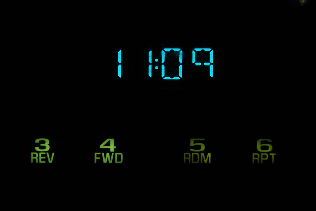 An LED clock showing 11:09.