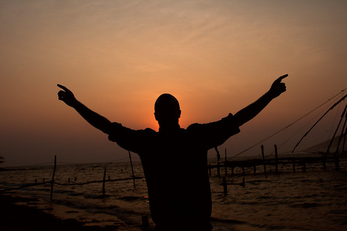 Sunset at Fort Cochin with Christian in silhouette