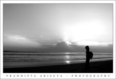 Live must go on (juzz_arisuta) Tags: sunset bw beach beautiful canon 50d
