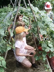 Children in a bean pole tent (Photo courtesy of the University of New Hampshire)