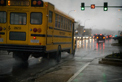 365_239 / Rainy Rush Hour (DAJanzen) Tags: texture wet fog reflections dreary headlights schoolbus atmospheric taillights wetpavement genevaillinois nikond200 nikonafsnikkor1755mm128g rainymorningcommute takenoutofthedriverswindow greatshootingweather