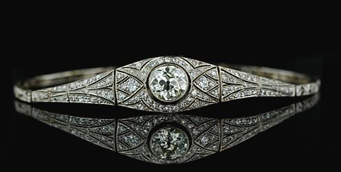 done in platinum and totals 4 carats of diamonds. Price: $19,500
