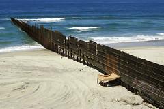 borderline (sam b-r) Tags: ocean sea usa beach water fence mexico us sand unitedstates pacific sandy border shoreline shore edge northamerica bajacalifornia barrier coastline baja tijuana hispanic seashore limit divide mexicousaborderfence s423516 sambrimages