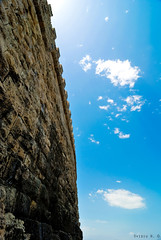 Off the wall (Ovidiu H.) Tags: city blue summer sky monument wall clouds island seaside europe capital medieval historic creta greece crete fortress heraklion iraklion kriti tokina1224f4 irakleio agiapelagia nikond80 koules venitianfortress