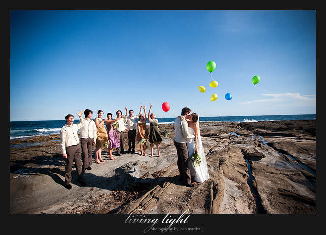 Bridal party release balloons. On the rocks behind Newcastle Baths.