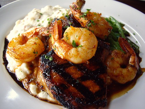 "Savannah ""Surf & Turf"" Brown Sugar Brined Grilled Pork Chop, BBQ Gulf Shrimp, Buttermilk Mashers, Fresh Skillet Beans, Bourbon Molasses Redeye Gravy"