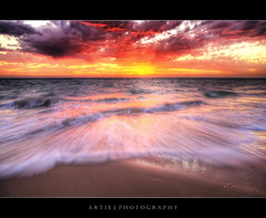 Saturation Rush :: HDR (:: Artie | Photography ::) Tags: sunset red sea sky seascape beach water clouds photoshop canon sand waves cs2 tripod australia wideangle shore rush damn adelaide 1020mm hes southaustralia glenelg hdr foreshore artie 3xp sigmalens photomatix glenelgbeach gooood tonemapping tonemap 400d rebelxti