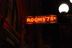 State Hotel (lydiafairy) Tags: seattle red orange color reflection building sign night lights washington nikon neon nightlights with room sidewalk nothing naranja pioneersquare rhymes blorenge rhymeswithorange d80 netneutrality 18135mm matters2me
