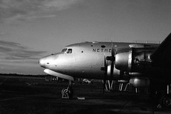 DC-4 at sunset, Aviodrome (Ronald_H) Tags: sunset bw classic museum nikon kodak aircraft trix processing push grainy douglas fm airliner redfilter 1600iso aviodrome dc4