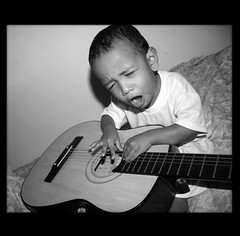 .tiny musician. (emadivine) Tags: boy bw music baby playing rock dark child you guitar brother expression candid flash border sing scream musicalinstrument bigmomma unanimous babymomma challengeyouwinner youvsthebest fcgsecondchance thechallengefactory emadivine fotocompetition fotocompetitionbronze fotocompetitionsilver fcsilver fcgold fotocompetitiongold thepinnaclehof