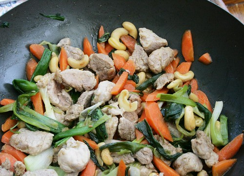 Pork fillet stir-fry with carrots, spring onions and cashews