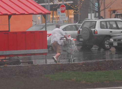 Shopper Running in Rain