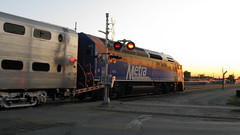 Westbound Metra commuter local at sunset. franklin Park Illinois. Early June 2009.