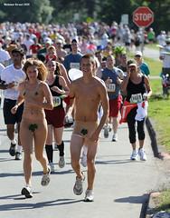 Adam and Eve (naturalturn) Tags: sanfrancisco california goldengatepark park shirtless usa couple run runners runner figleaf 2009 baytobreakers image:rating=4 baytobreakers2009 image:id=073500