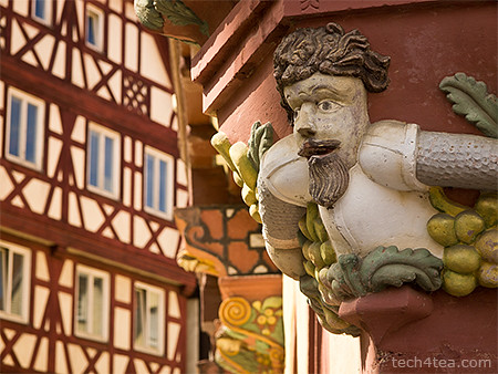 Relief on the corner of a building in Mosbach, with half-timbered houses in the background. Taken with an Olympus E5