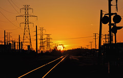 Dusk (Ben Morrow) Tags: old railroad light sunset sky orange sun lines silhouette century train lights spring texas crossing telephone towers industrialrevolution wires rails electricity poles february signal 2009 transmission outdated richardson powergrid twentieth early20thcentury abigfave nikond90