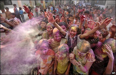 School children celebrate Holi with colours