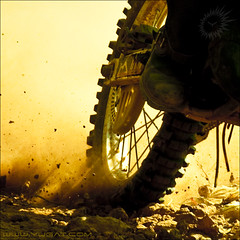 Life's just a blast that's movin' really fast, you better stay on top or life will kick you in the ass. (Yug_and_her) Tags: light bike wheel speed nikon shoes ride mud action stones fast pebbles dirt dust streaks rider tyre particles hispeed volume d90 bsquare acinematicworld