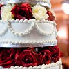 red flowers red wedding cake white wedding cake photo