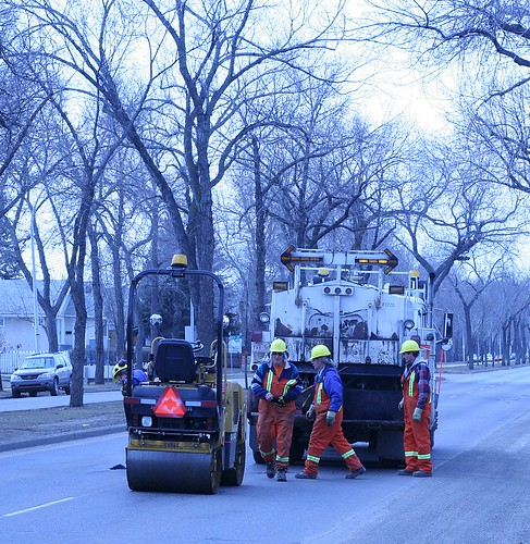 Workers fill potholes in Edmonton