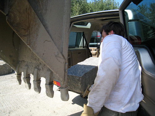 granite step going into the car via back hoe