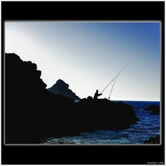 AZUL Y NEGRO (Charly JPG (Carlos Jos Prez)) Tags: sea espaa mer water azul contraluz mar fisherman spain agua eau mediterraneo mare negro acqua espagne almera cabodegata spagna pescador azulynegro canoneos40d charlyjpg