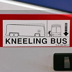 KNEELING BUS (Leo Reynolds) Tags: sign canon eos iso100 sticker arrow f56 peril signsafety 140mm signbad 0008sec 40d hpexif grouparrows groupperil xratio11x xleol30x