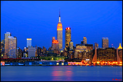 Empire State Building at Blue Hour (Moniza*) Tags: city nyc newyorkcity longexposure ny newyork reflection water skyline night skyscraper river geotagged newjersey cityscape manhattan illumination newyorker midtown nightlight esb hudsonriver empirestatebuilding gothamist bluehour unioncity hoboken weehawken gothamcity thebigapple westnewyork lightstream unionhill onepennplaza flickrgoldaward moniza flickrsilveraward yourarthastouchedtheworldaward universaleliteaward andromeda50award
