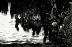 procession on the river (Le Xuan-Cung) Tags: people blackandwhite bw water river nikon mood afternoon citylife streetshots streetphotography atmosphere streetlife streetscene nb celebration sw priest tamil hamm sunnyday nikond1x believer polfilter livingingermany circularfilter uentrop characterstudies srikamadchiampaltemple livinginnrw faithofpeople focallength450mm