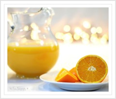 Fresh Juice (Tracey Tilson Photography) Tags: life stilllife food orange glass still bokeh juice fresh slice pitcher picnik squeezed storybookwinner storybookbtd1st