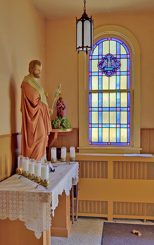Immaculate Conception (Saint Mary's) Roman Catholic Church, in Brussels, Calhoun County, Illinois, USA - statue of Saint Joseph and window with eagle and fish symbols