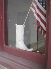 BOOT WITH U.S.FLAG IN WINDOW (roberthuffstutter) Tags: windows white art glass leather stars for march women boots stripes flags smell views transparency snapshots americanflags behind variety cowgirls drawers kcmo artphotos showoffs bldgs stompinboots windowreflections cowgirlboots glassreflections bootsmadeforwalking of womensboots newsets assortedsnapshots flagss huffstutter roberthuffstutter gloryboots viewsthroughwindows filingsystems leatherpatriotsold showofftheboots patrioticboots womenswhiteleather rightboots counttheviews flagwavingbootstompingpatriots peekingatdrawers drawersondisplay honestyingovernment scottbrownsvictoryaboutamerica bobhuffstutter coolsnapshots