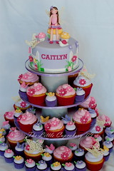 Caitlyn's Fairy Birthday Cupcake Tower (TheLittleCupcakery) Tags: birthday pink mushroom yellow cake cupcakes purple little violet butterflies snail fairy caitlyn tlc fondant cupcakery xirj klairescupcakes