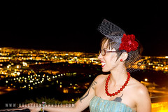 The bride with the lights of Las Vegas in the background.