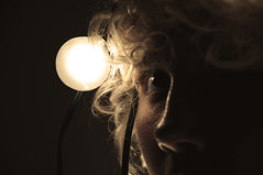 Untitled. (havana.rama) Tags: light shadow portrait woman eye girl sepia bulb lady vintage nose lights lashes eyelashes curls retro cast bulbs