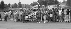Demonstrators singing to the crowd (old_skool_metal_head) Tags: tx demonstration wamm demonstrator kodaktrixpan womenagainstmilitarymadness trix5063 senecaarmydepot romulusnewyork antinucleardemonstration