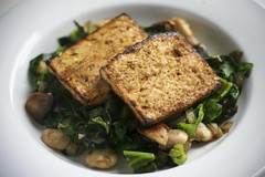Grilled Tofu on Spring Greens Sauteed with Onion, Garlic, Mushrooms, Butter Beans, and Thyme