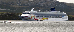 norwegian sun cruise ship  ar anchor off stanley Tender ferries passengers from anchorage to town