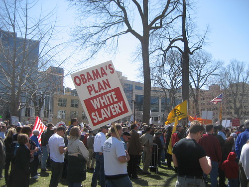 """Tea Party protester with """"White Slavery"""" poster"""