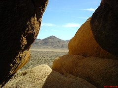 (Cyrus II) Tags: cameraphone california ca blue sky usa cloud mountain mountains tree rock mobile stone clouds se nationalpark rocks desert walkman joshua stones sonyericsson cellphone sunny kalifornien w810 w810i